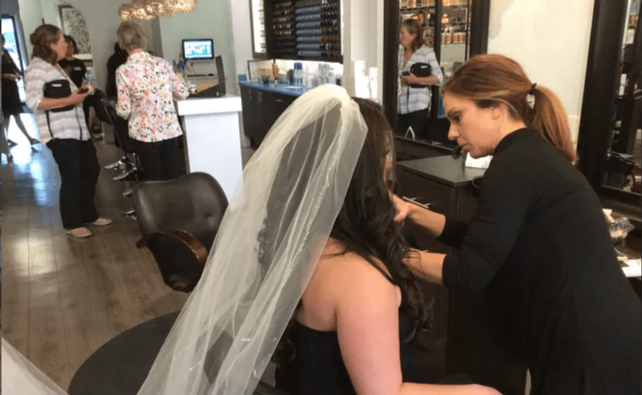 Bride with veil getting ready