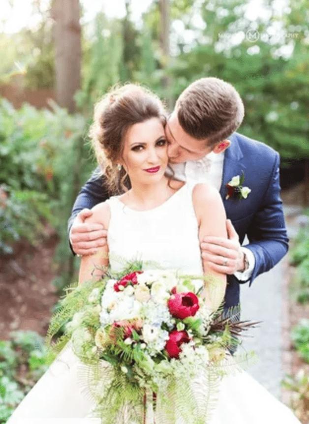 Groom kissing brides cheek